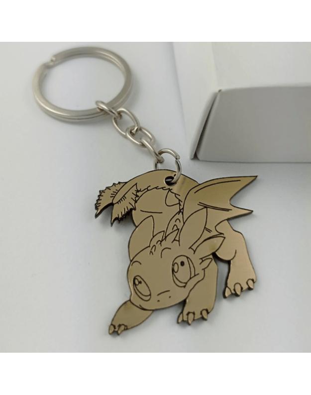 Graviruotas raktų pakabukas auksinis dinozauras
