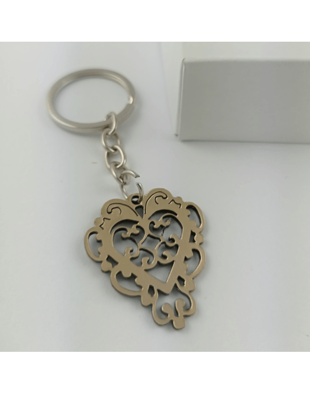 Graviruotas raktų pakabukas auksinis ornamentas